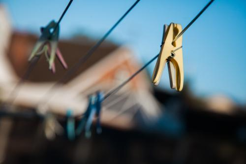 Close up of clothes pegs on a drying line