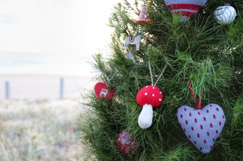 Close up of decorated Christmas tree at beach