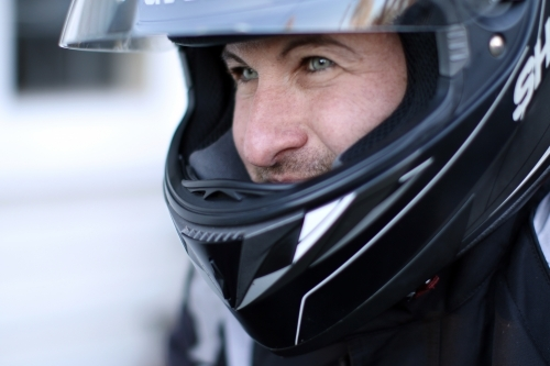 Close up of man wearing a motorbike helmet