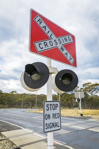 Close up of railway crossing sign