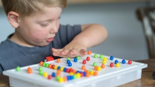 Close up of toddler playing puzzle game