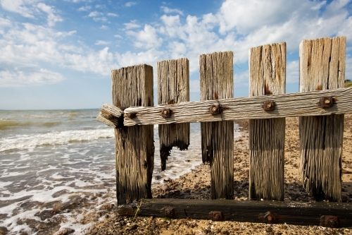 close up of wooden groyne at a regional beach