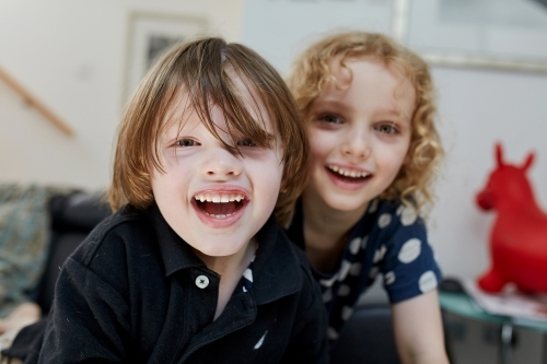 Close up of young boy and girl smiling