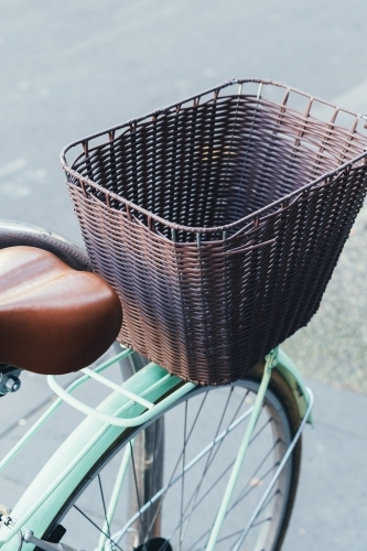 Closeup of a retro blue bicycle's basket.