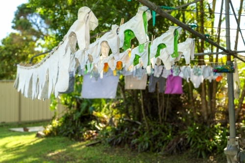 Cloth nappies hanging on clothes line.