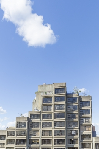 Clouds over concrete apartments