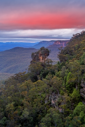 Cloudy skies hover above and stunning views to Orphan Rock, Blue Mountains, Australia