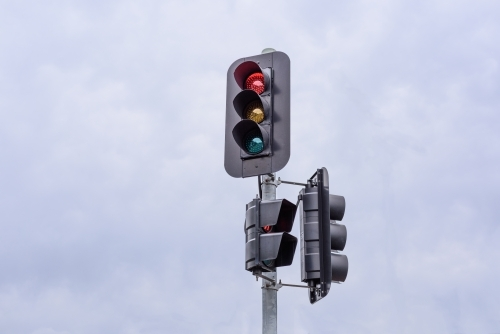 Cloudy sky background traffic lights