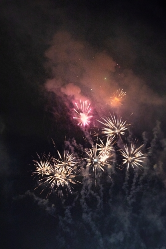 Colourful fireworks display in sky at night