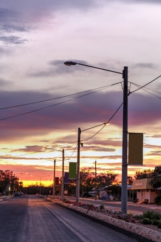 Colourful sunrise over street in a country town.