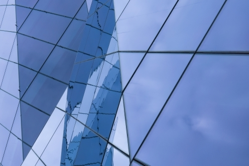 Complex Glass Facade with Reflections of the Sky