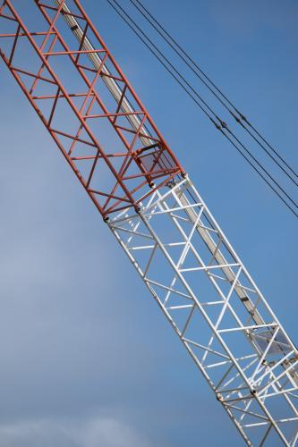 Construction crane red and white boom close up