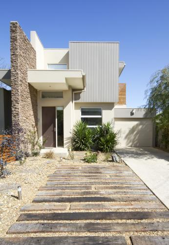 Contemporary townhouse home facade and driveway
