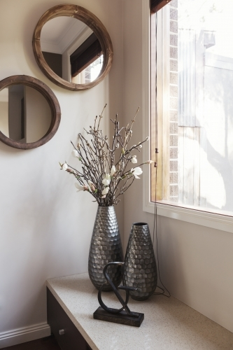 Corner decor details of vase and wall mirrors