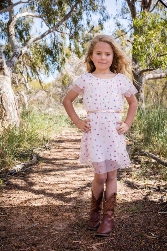 Country girl with polka dot dress and cowboy boots