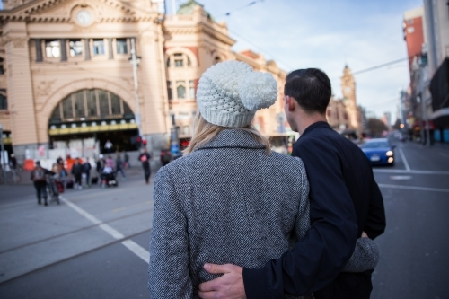 Couple Crossing Flinders Street to the Station