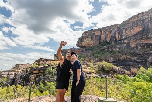 Couple taking selfies at Nourlangie, Kakadu