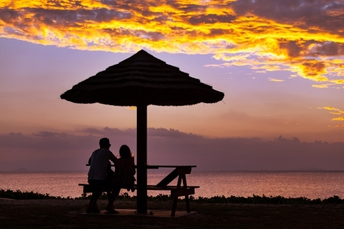 Couple watching sunset at Cape Gloucester.
