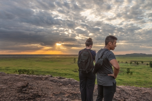 Couple watching sunset at Ubirr, Kakadu national Park