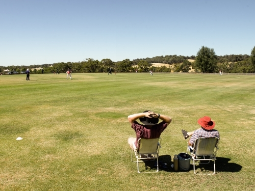 Spectators at a T20 cricket match in the country