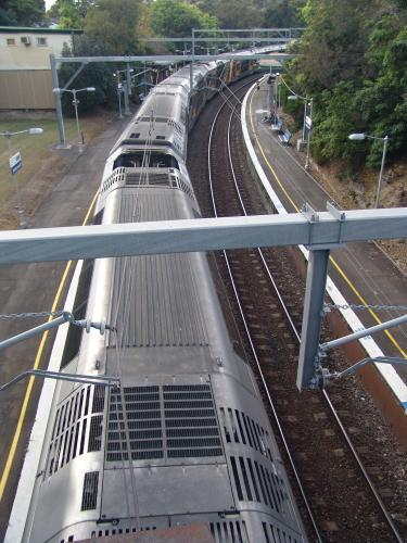 Overhead view of a train passing along a track