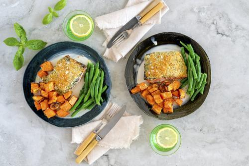 Crumbed salmon with green beans presented on table