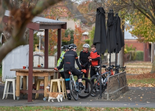 Cyclists talking at a cafe after a morning ride