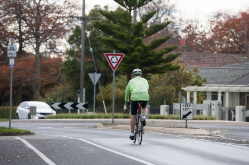 cyclist approaching a roundabout in the city