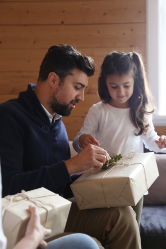 Dad and daughter opening present