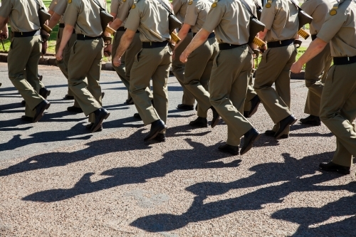 Shadows and legs of marching soldiers in the Australian Defense Force