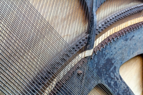 Detail of strings on the back of a piano