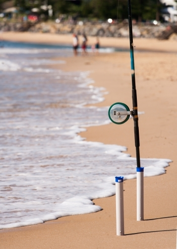 Fishing rod in holder on a beach