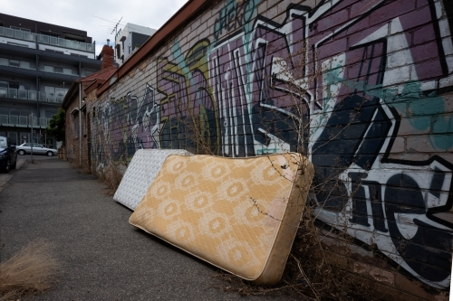 Discarded mattresses on street in inner city suburb