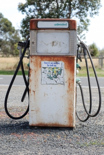 An old rusty petrol bowser in the country