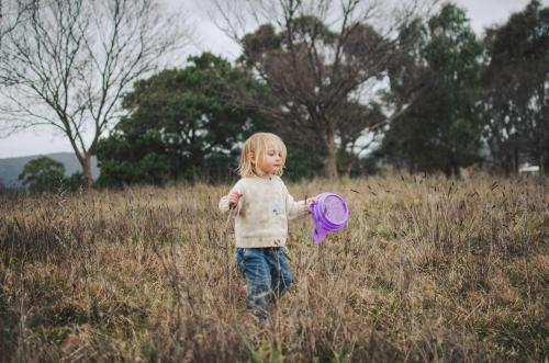 Little girl playing in a field