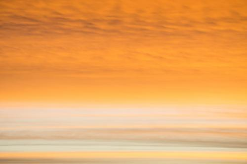 Close up section of a orange sunset sky