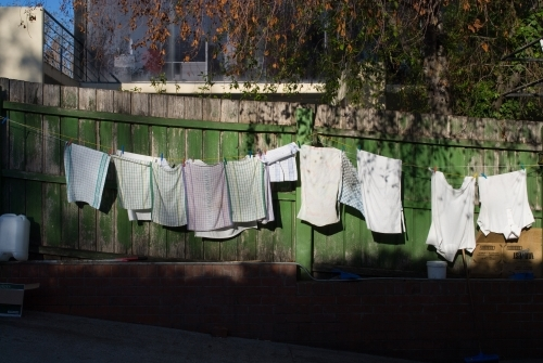 Makeshift clotheslines behind a cafe