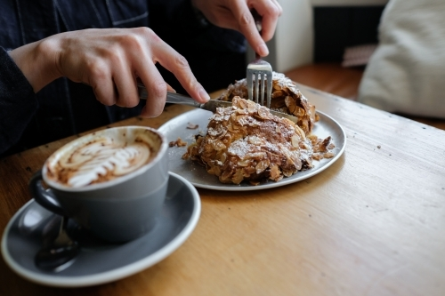 Almond croissant breakfast with cup of coffee