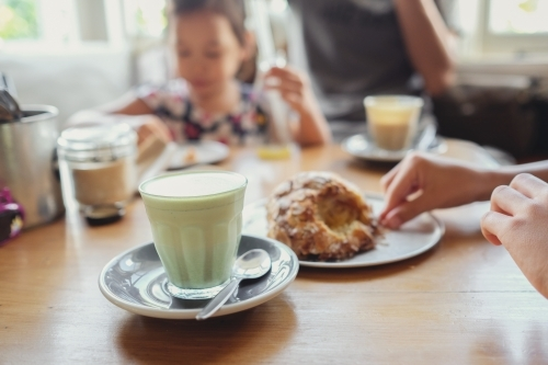 Matcha green tea latte with family background