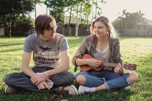 Teenagers with ukulele in the park