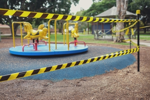 Safety black and yellow tape blocking off playground