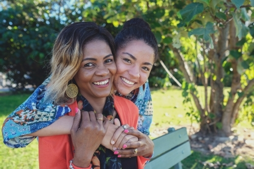 African mother and multicultural teen daughter