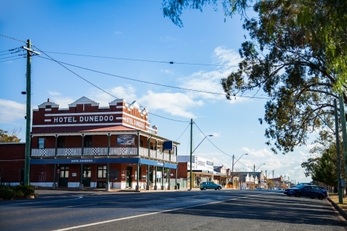 Hotel Dunedoo and sunlit main street of small town