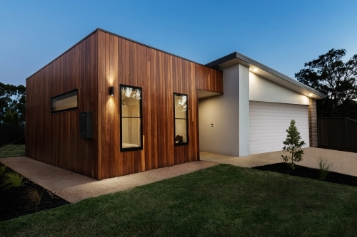 Dusk shot of a modern home with external lighting