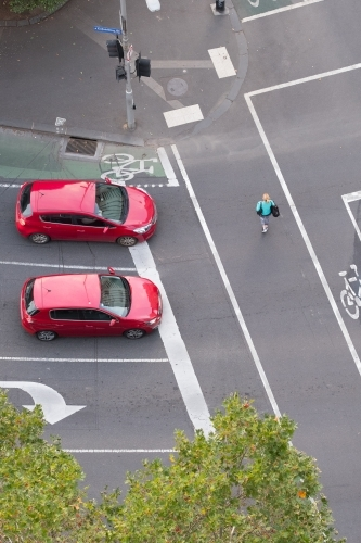 Red cars at red traffic signal in Melbourne CBD from above