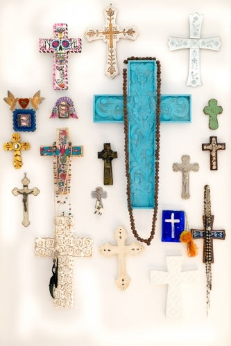 Display wall of crucifixes and beads