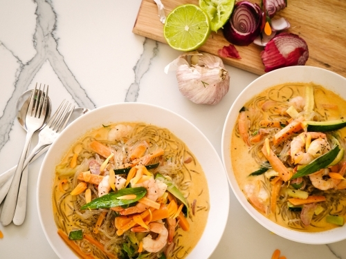 Thai red prawn noodles served up in bowls ready to eat