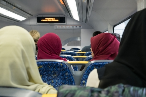 Young muslim women wearing hijab on public transport