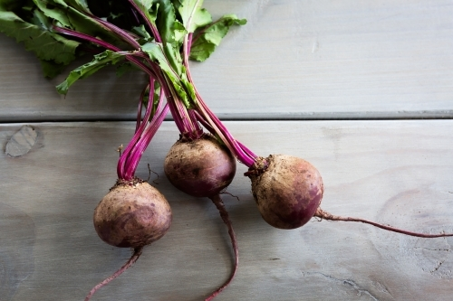 Rustic beetroots on a grey wood table