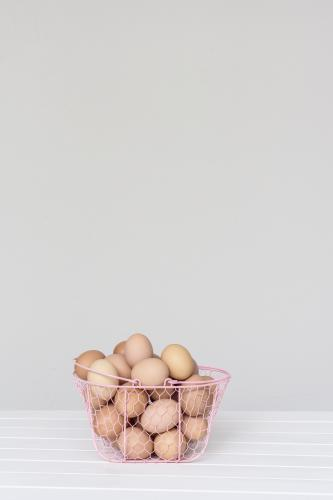 eggs in a pink wire basket